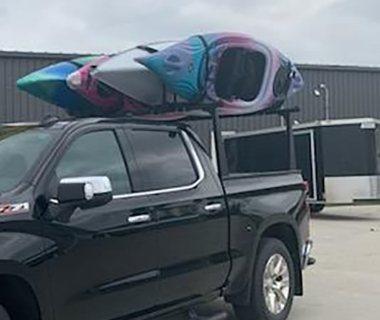 4 Kayaks on Adarac Pro Truck Rack