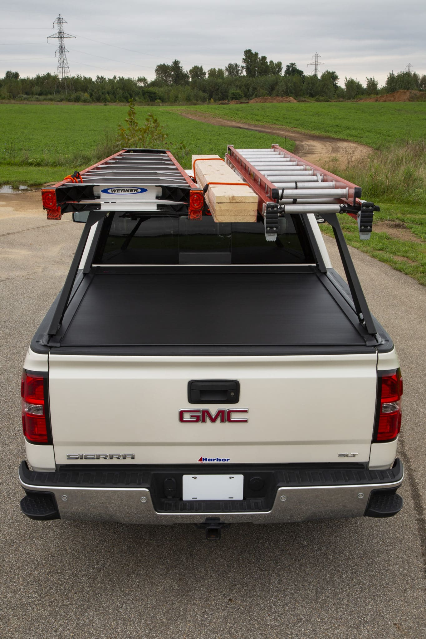 Ladders Mounted on Tonneau Rack