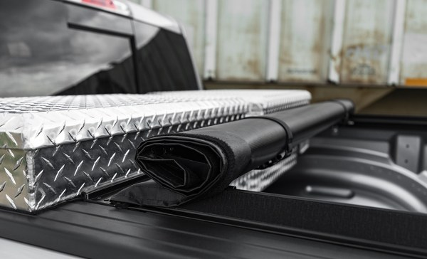 Rolls Up Stores Behind Toolbox
